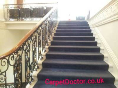 Commercial carpet repair on public staircase.